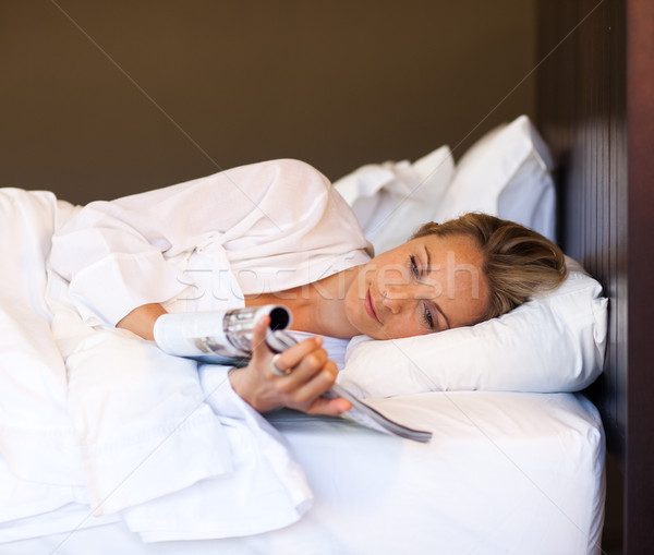 Young woman reading a magazine in bed Stock photo © wavebreak_media