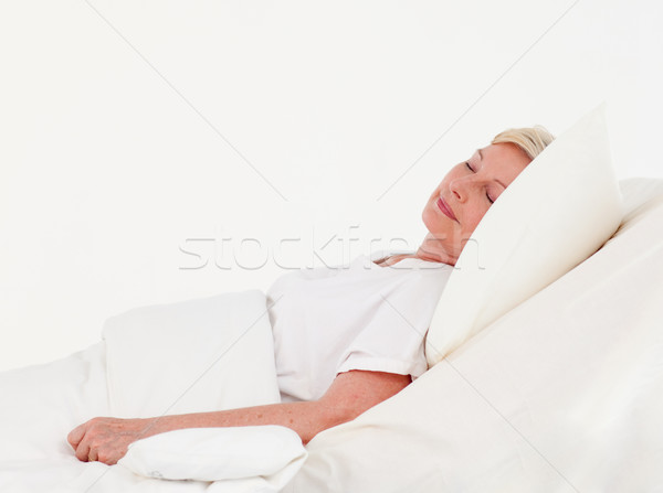 Old woman rocovering in a hospital against white background Stock photo © wavebreak_media