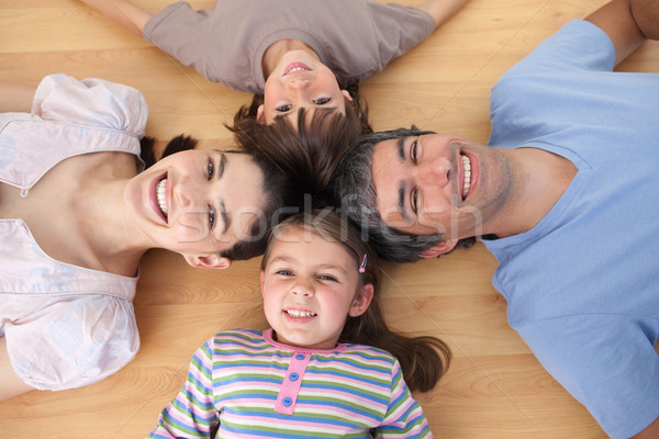 Lively family lying on the floor with heads together Stock photo © wavebreak_media