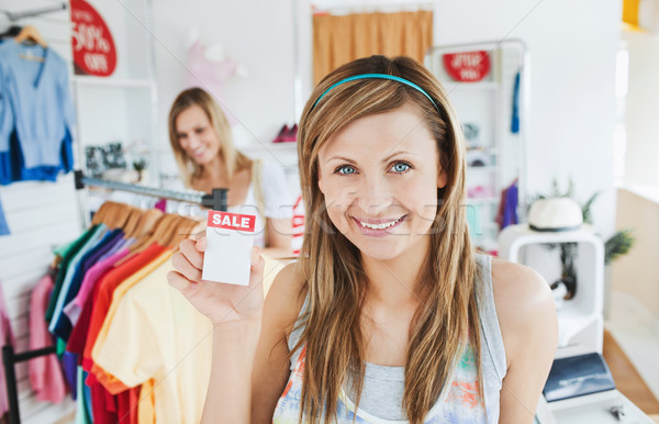 Positive young woman smiling at the camera doing shopping with her friend in a shop Stock photo © wavebreak_media