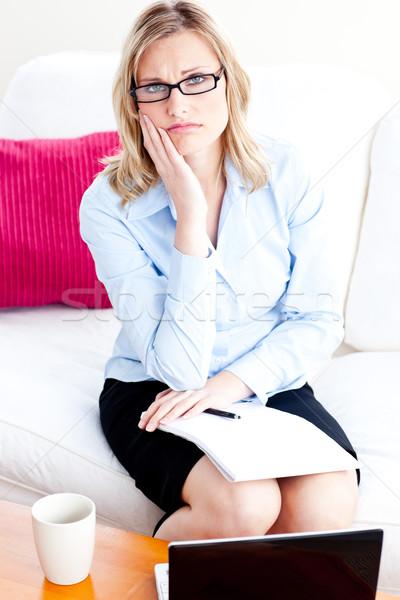 Depresji za pomocą laptopa biuro patrząc kamery papieru Zdjęcia stock © wavebreak_media