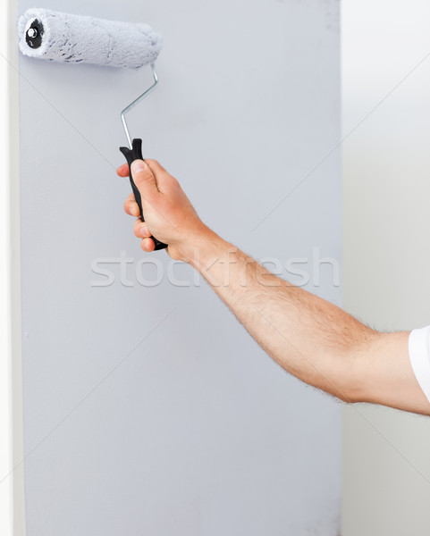 Close up of a man painting a wall in white in his new house Stock photo © wavebreak_media