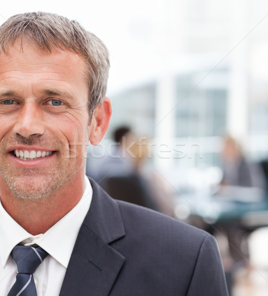 Smiling businessman in his office Stock photo © wavebreak_media