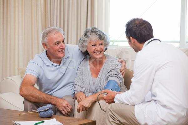 Doctor taking the blood pressure of his patient Stock photo © wavebreak_media