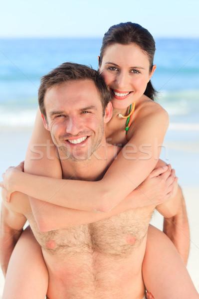 Man having wife a piggyback on the beach Stock photo © wavebreak_media