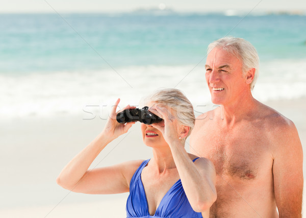 Elderly couple bird watching at the beach Stock photo © wavebreak_media