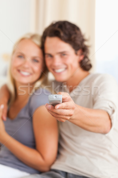 Portrait of a young couple watching TV in their living room Stock photo © wavebreak_media