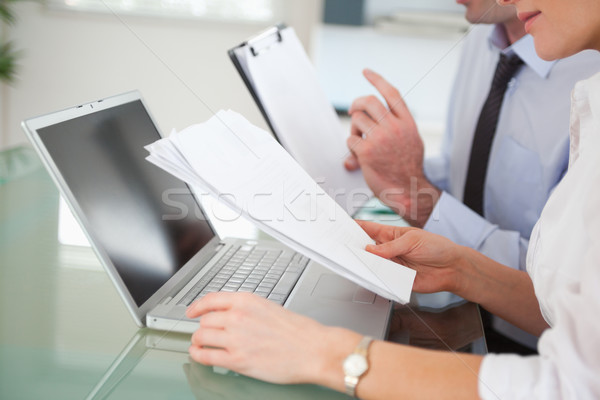 Managers comparing a blueprint document to an electronic one in an office Stock photo © wavebreak_media