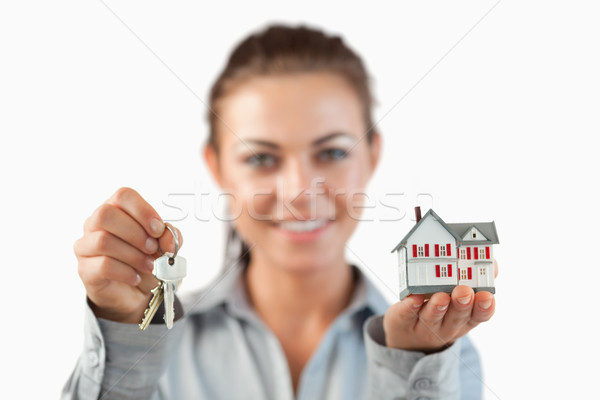 Tasti miniatura casa femminile agente immobiliare bianco Foto d'archivio © wavebreak_media