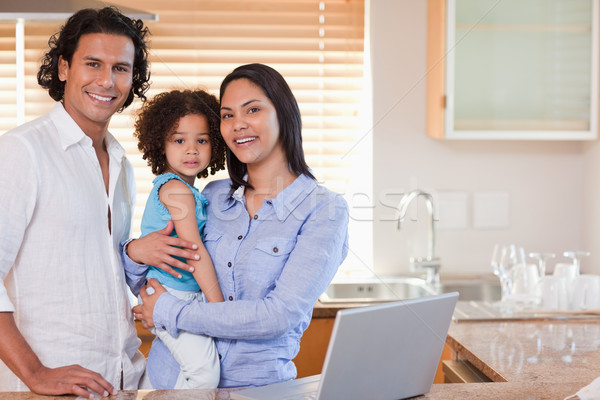 Young family surfing the web in the kitchen together Stock photo © wavebreak_media