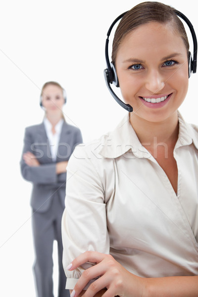 Portrait of operators with headsets against a white background Stock photo © wavebreak_media