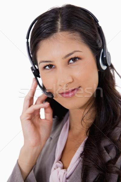 Olhando empresária fone branco negócio sorrir Foto stock © wavebreak_media