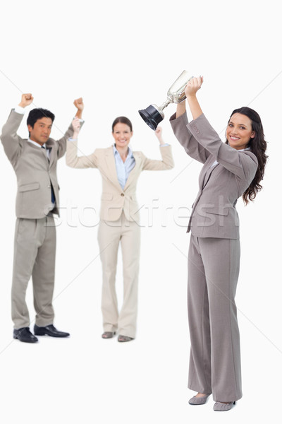 Successful tradeswoman holding cup against a white background Stock photo © wavebreak_media