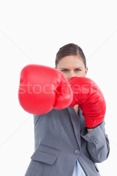 Tradeswoman with boxing gloves attacking with right fist against a white background Stock photo © wavebreak_media