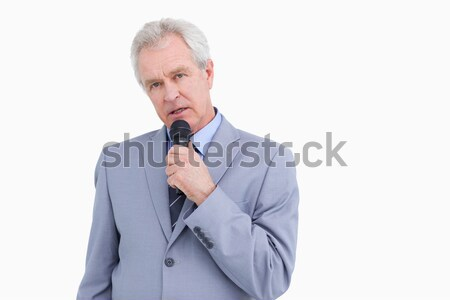 Mature tradesman speaking into microphone against a white background Stock photo © wavebreak_media