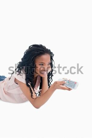 Sorridente jovem piso televisão controle remoto Foto stock © wavebreak_media