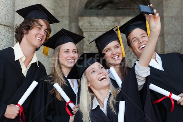 Gelukkig afgestudeerden foto universiteit Stockfoto © wavebreak_media