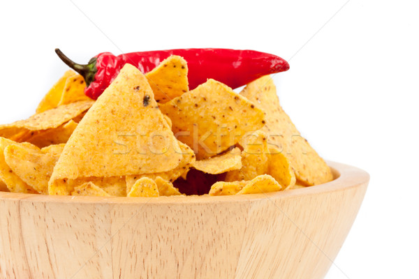 Pepper upon a bowl full of crisps against white background Stock photo © wavebreak_media