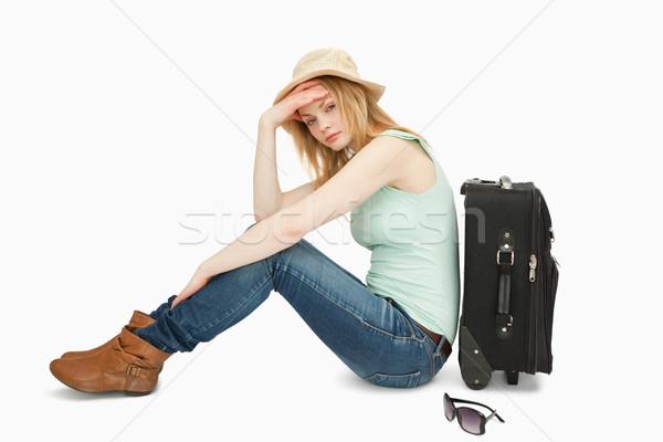 Annoiato donna seduta valigia bianco mano Foto d'archivio © wavebreak_media