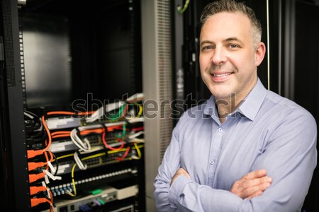 Man standing with arms crossed in data center in front of servers Stock photo © wavebreak_media