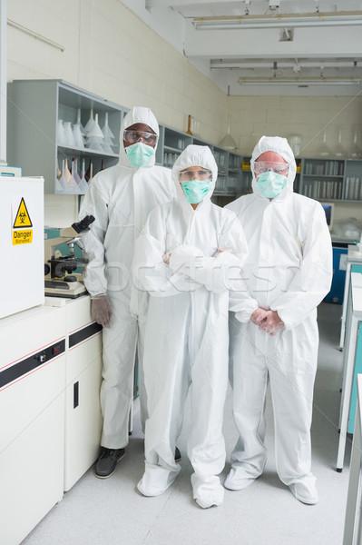 Csapat öltönyök áll labor nő iroda Stock fotó © wavebreak_media