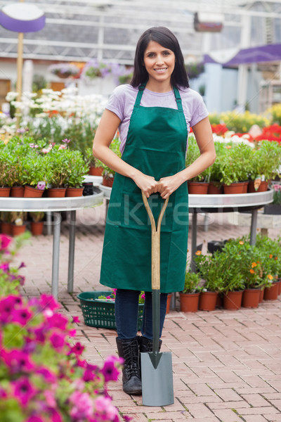 Florist holding a spade while smiling Stock photo © wavebreak_media