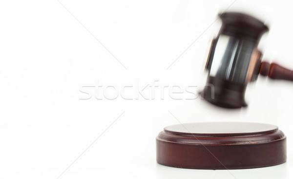 Stock photo: Moving gavel banging on the wood sound block on white background