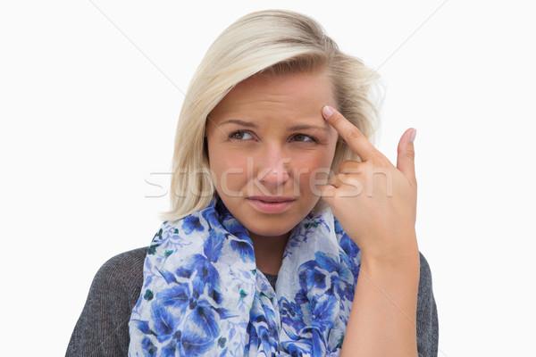 блондинка указывая лоб белый мышления Сток-фото © wavebreak_media
