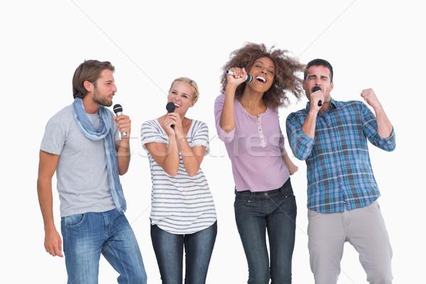 Leuk groep zingen karaoke witte microfoon Stockfoto © wavebreak_media