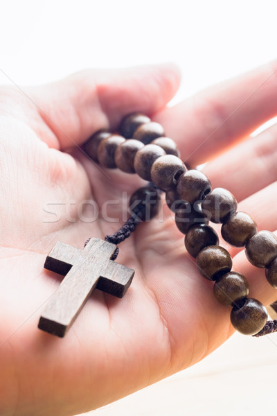 Hand holding wooden rosary beads Stock photo © wavebreak_media
