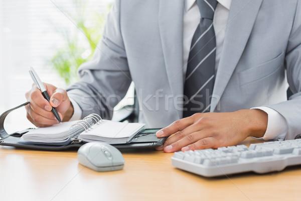 Biznesmen piśmie dziennik Zdjęcia stock © wavebreak_media