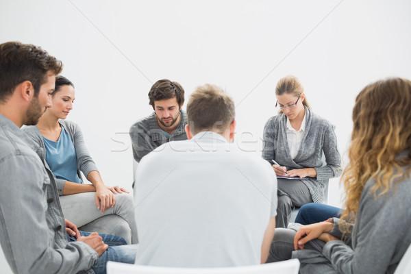 Grupo terapia sesión círculo terapeuta mujer Foto stock © wavebreak_media