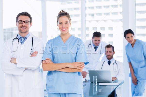 Artsen collega's met behulp van laptop medische kantoor portret Stockfoto © wavebreak_media