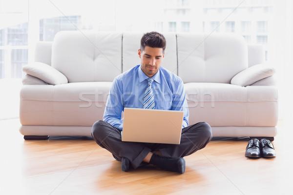 Businessman sitting on floor using laptop  Stock photo © wavebreak_media