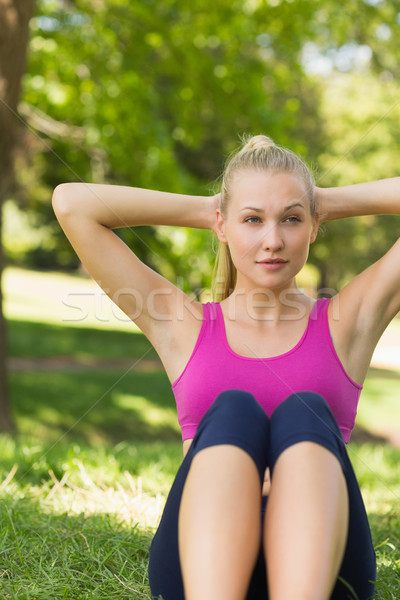 Healthy and beautiful woman doing stomach crunches in park Stock photo © wavebreak_media