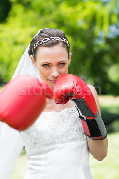Bride with boxing gloves punching in garden Stock photo © wavebreak_media