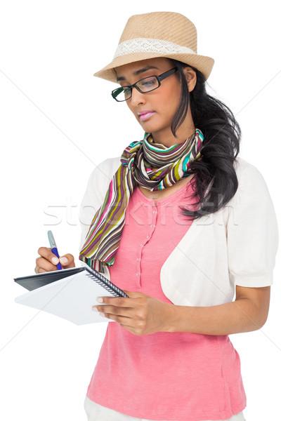 Poważny cool młoda kobieta piśmie notatnika biały Zdjęcia stock © wavebreak_media