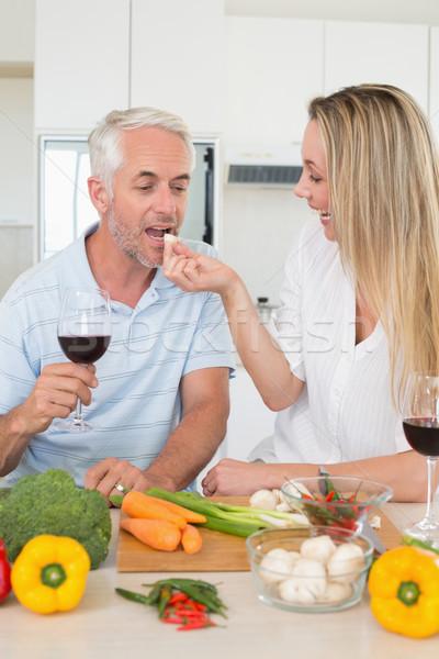 Afetuoso casal jantar juntos potável vermelho Foto stock © wavebreak_media