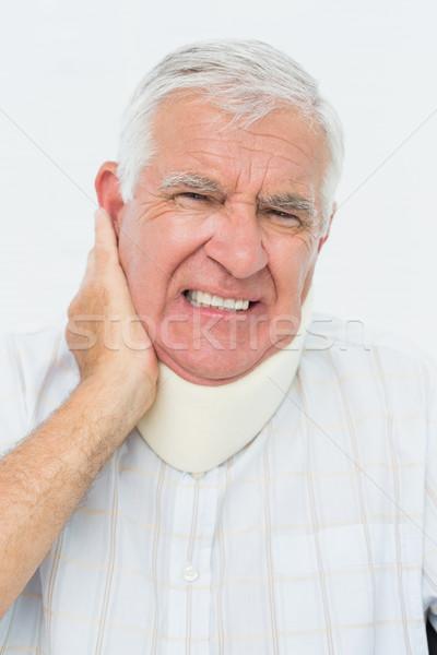 Close-up portrait of a senior man with cervical collar Stock photo © wavebreak_media