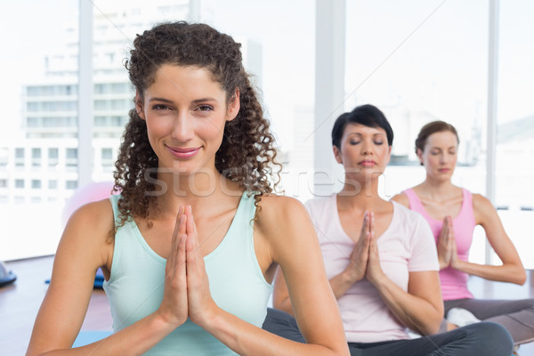 Women with joined hands at fitness studio Stock photo © wavebreak_media