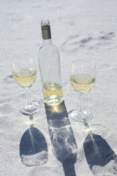 White wine bottle and glasses on the sand Stock photo © wavebreak_media