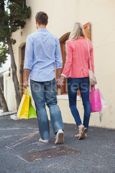 Stylish young couple standing with shopping bags Stock photo © wavebreak_media