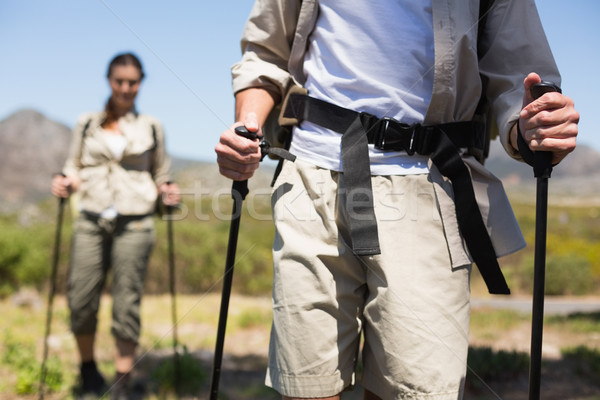 Hiking couple walking on mountain trail Stock photo © wavebreak_media