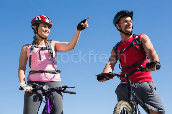 Fit cyclist couple standing at the summit Stock photo © wavebreak_media