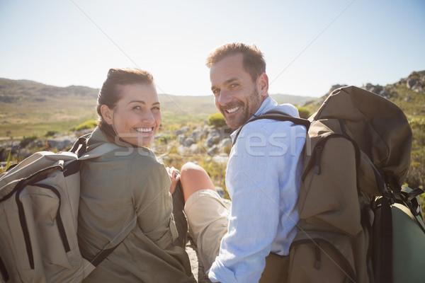 ハイキング カップル 座って 山 地形 笑みを浮かべて ストックフォト © wavebreak_media
