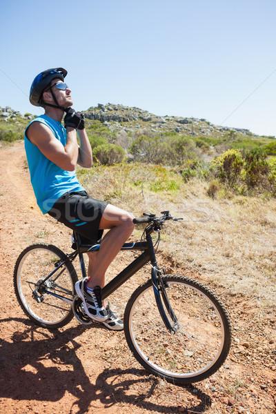 Fitt kerékpáros megjavít pánt sisak napos idő Stock fotó © wavebreak_media