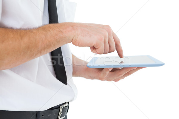 Businessman scrolling on his tablet pc Stock photo © wavebreak_media