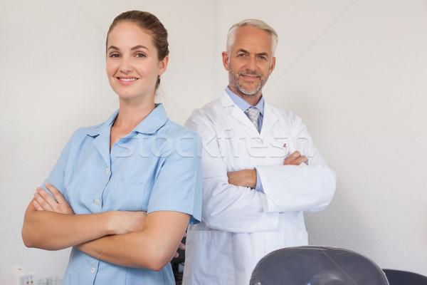 Dentiste assistant souriant caméra dentaires clinique Photo stock © wavebreak_media