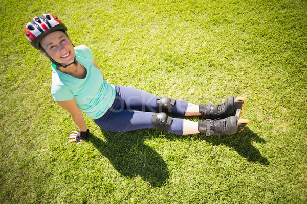 Fit mature woman in roller blades on the grass Stock photo © wavebreak_media