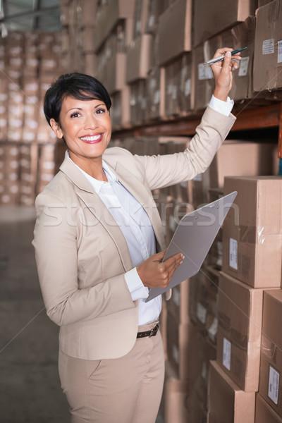 Pretty warehouse manager checking inventory Stock photo © wavebreak_media